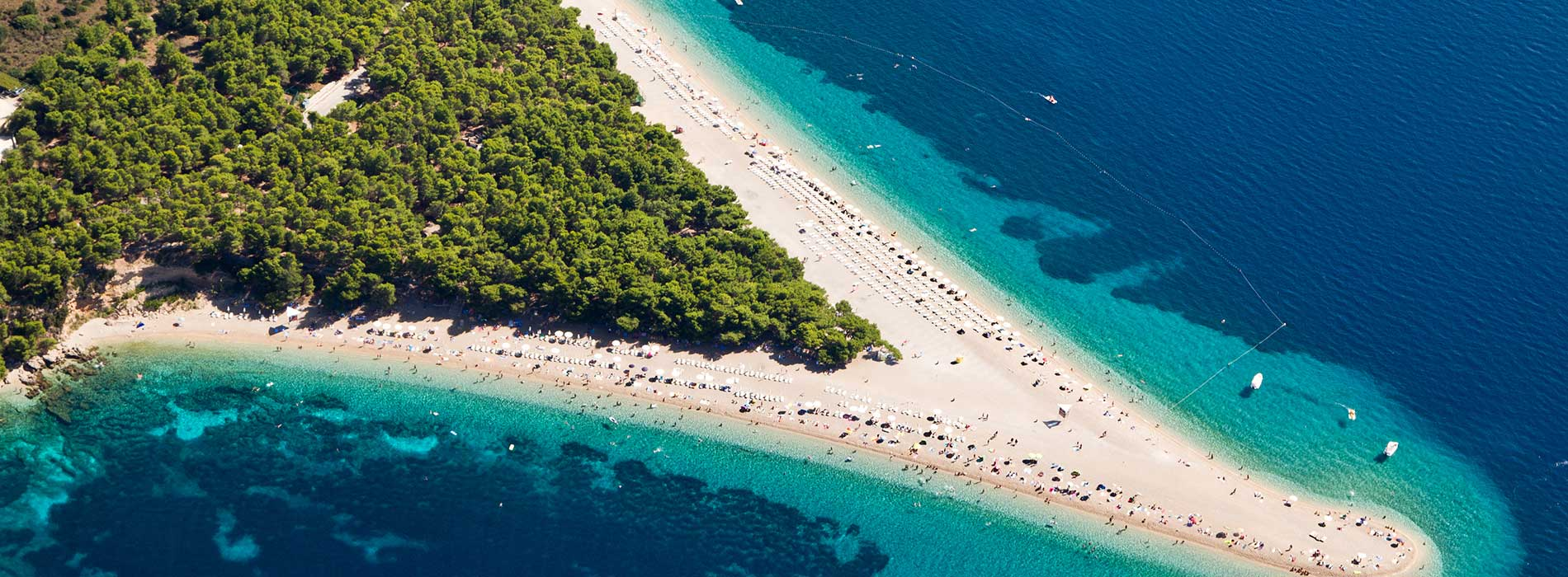 Aerial photograph of famous Zlatni Rat beach in Bol, Brac Island.jpg