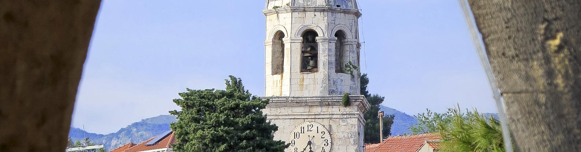 Tower at Cavtat Harbor in Dalmatia.jpg